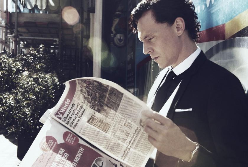 Tom-Hiddleston-reading-newspapers-elegant-man-photoshoot